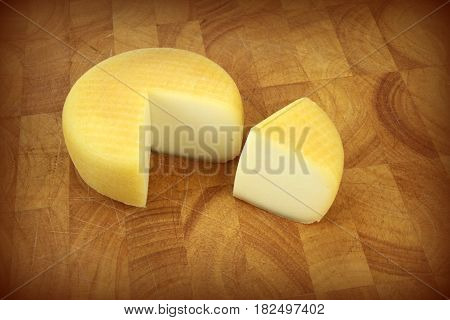 Cheese on a kitchen board close up image