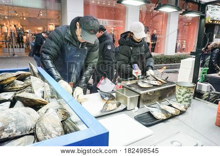 couple prepare burned mussels for selling to the buyer taken in Seoul South Korea on 14 February 2017
