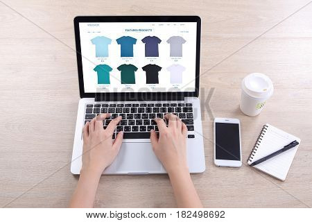 Business woman choosing tshirt on ecommerce webshop