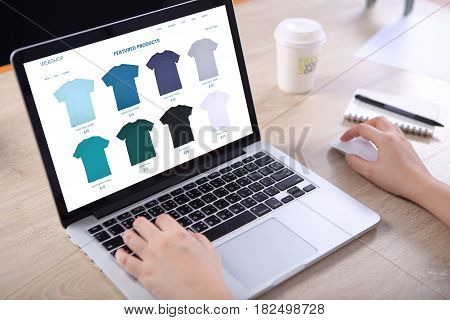 Business woman choosing tshirt on ecommerce webshop