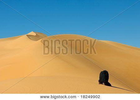 Man Praying In The Sahara Desert, Libya