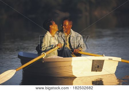 Senior African couple in row boat