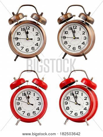 Retro the alarm clock of bronze and red color at twelve o'clock isolated on a white background. Midnight midday. Minutes about New year.