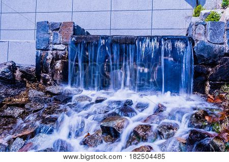 Closeup of a small waterfall at local lakeside park in South Korea
