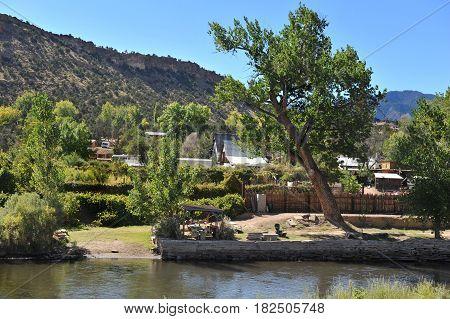 A small town nestles along the river flowing through Colorado's Royal Gorge
