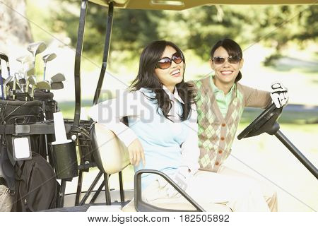 Two women in golf cart
