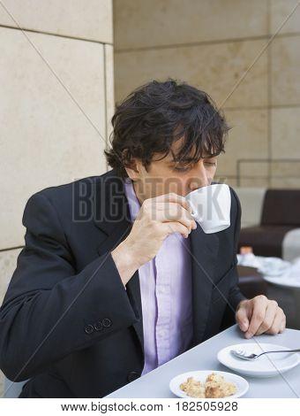 Businessman drinking coffee at restaurant