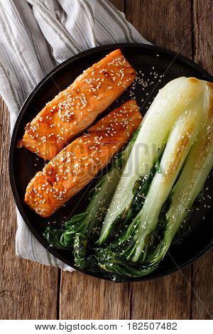 Salmon In Honey-soy Glaze And Fried Bok Choy Close-up. Vertical Top View
