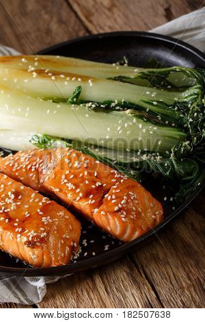 Salmon In Honey-soy Glaze And Fried Bok Choy Close-up. Vertical