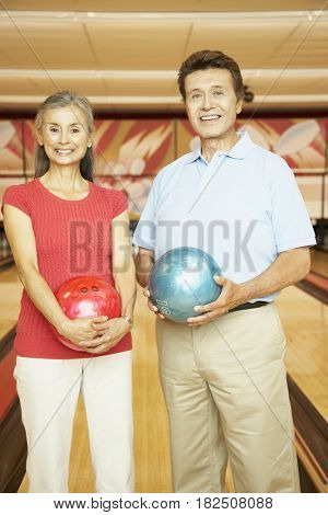 Portrait of senior Hispanic couple at bowling alley