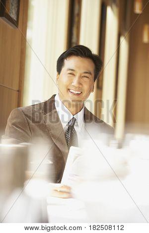 Portrait of Asian businessman indoors