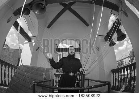 Kiev, Ukraine - 31 July 2016: The Bell-ringer In The Kiev Svyato-vvedensky Monastery. Black And Whit