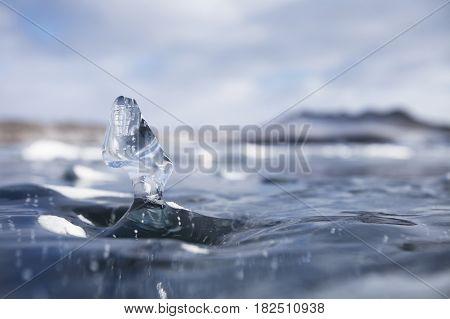 Transparent Ice Floe. Winter Baikal Lake