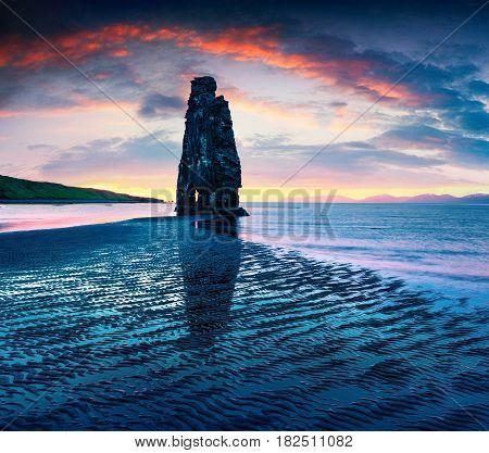 Huge basalt stack Hvtserkur on the eastern shore of the Vatnsnes peninsula. Colorful summer sunrise in northwest Iceland Europe. Artistic style post processed photo.