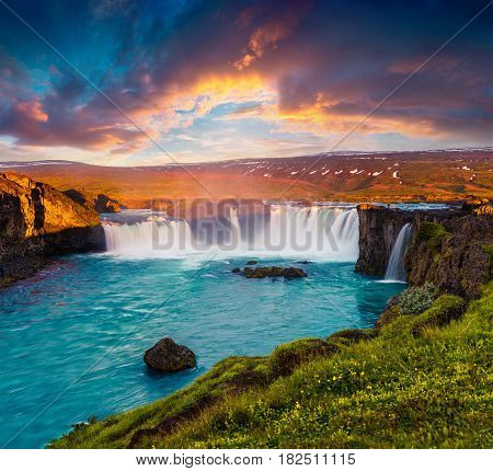 Summer morning scene on the Godafoss Waterfall. Colorful sunrise on the on Skjalfandafljot river Iceland Europe. Artistic style post processed photo.