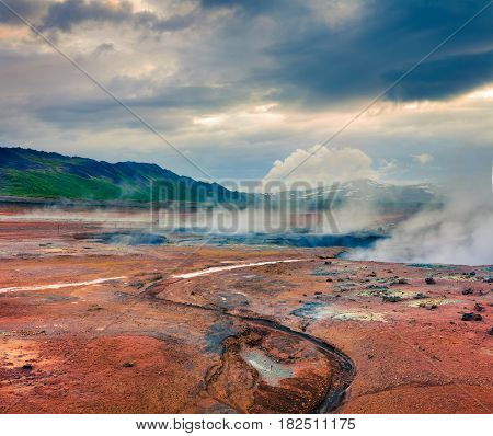 Steaming fumarole in geothermal valley Hverarond located near Reykjahlid village in north of Iceland Europe. Artistic style post processed photo.