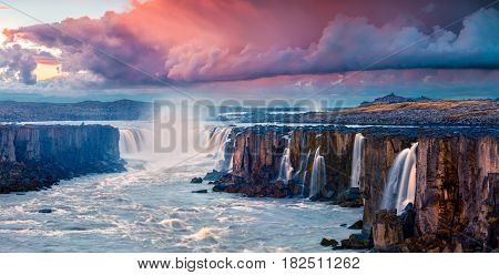 Colorful summer landscape on Jokulsa a Fjollum river. Beautiful sunrise scene on the Selfoss Waterfall in Jokulsargljufur National Park Iceland Europe. Artistic style post processed photo.