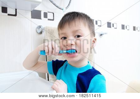 child portrait brushing teeth boy dental care oral hygiene concept child in bathroom with tooth brush, healthy lifestyle