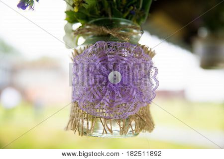 Decoration of lace fabric for a bouquet of flowers. In the center of the decoration button.