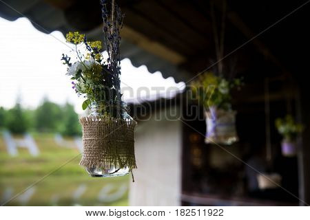 A bouquet of wild flowers hanging in the street. Close-up. Wedding decorations.