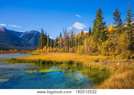 Magic Vermillon lake in the Rocky Mountains of Canada. Sunset on a clear sunny day. Concept of active tourism and ecotourism