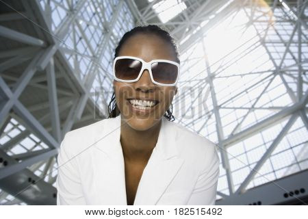 Low angle view of African woman wearing sunglasses