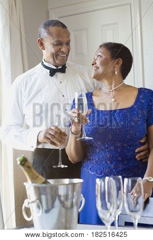 African couple drinking champagne