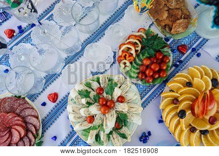 Banquet table with snacks on a blue tablecloth