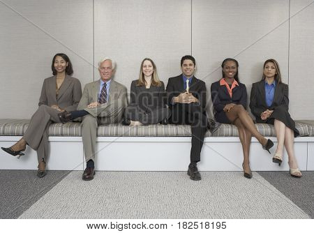 Multi-ethnic businesspeople sitting on bench