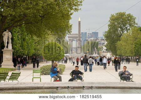 PARIS, FRANCE - APRIL 25, 2009: Walking people and Egyptian obelisk in the square of Concorde, Paris, France