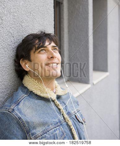 Hispanic man listening to music