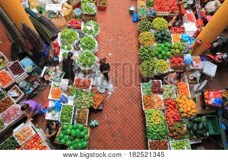 HANOI VIETNAM - NOVEMBER 22, 2016: Unidentified people shop at Cho Hom market.