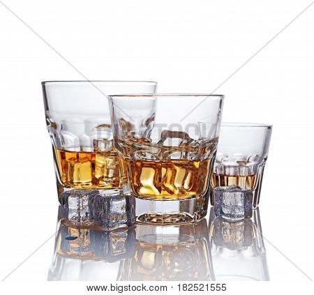 Three Glasses Of Scotch Whiskey With Ice Cube