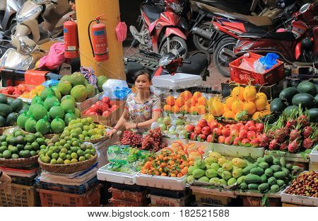 HANOI VIETNAM - NOVEMBER 22, 2016: Unidentified people sells fruits at CHO HOM market. CHO HOM market is an old fashioned local market.