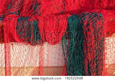 Bright red and green fishing net closeup
