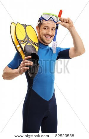Young man with a wetsuit and snorkeling equipment looking at the camera and smiling isolated on white background