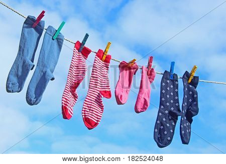 colorful socks on a clothesline against blue sky
