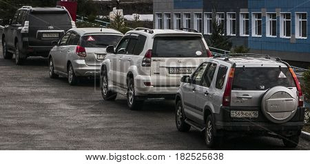 Kazakhstan, Ust-Kamenogorsk, april 13, 2017: Cars parked in a row, cars in a row
