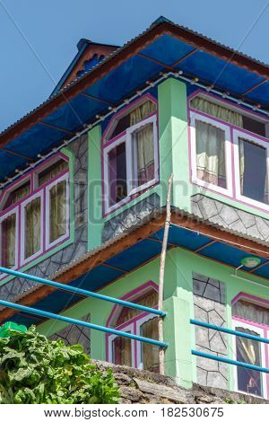 One of the colourful guesthouses built to accomodate the large number of hikers that come to walk along the many trails in the Annapurna region Nepal.