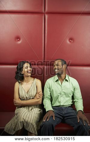 Multi-ethnic couple laughing