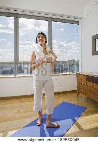 Hispanic woman holding glass water