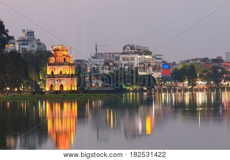 Hoan Kiem lake night cityscape in Hanoi Vietnam