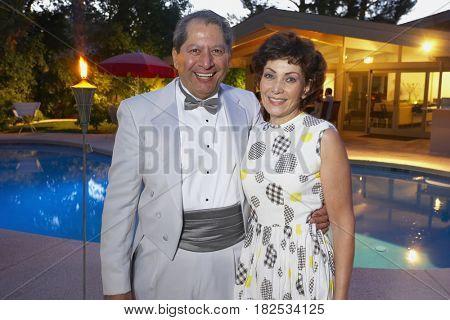 Multi-ethnic couple enjoying pool party