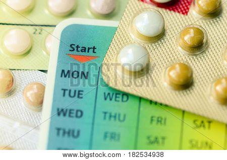 Contraception Education Concept with Oral contraceptive pills.