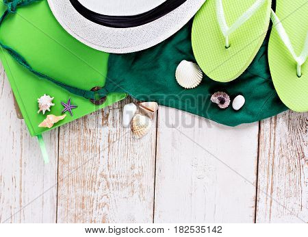 Summer rest. Going to the sea. Hat shells flip-flops notepad sunglasses. The sun the sea the summer the beach. Summer Holidays in Beach Seashore.
