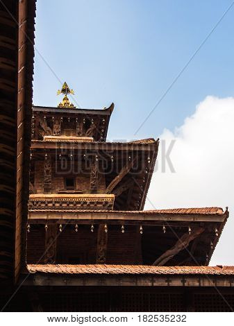 Looking up towards one of the multi leveled pagodas in historic Durbar Square in Patan. Kathmandu Nepal.