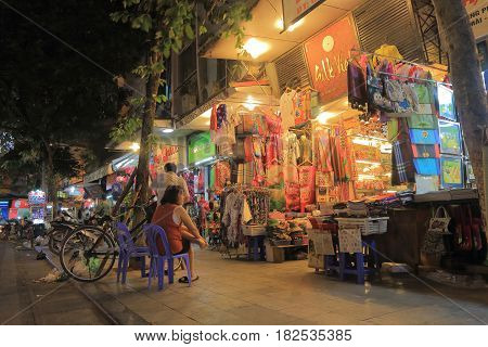 HANOI VIETNAM - NOVEMBER 22, 2016: Unidentified people visit Hang Gai Silk street. Hang Gai Silk street is famous for silk shopping.