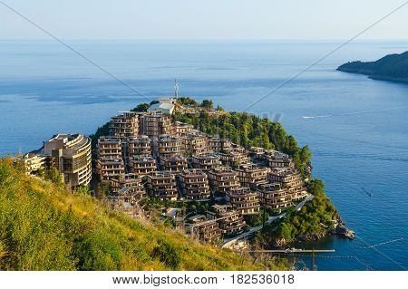 View of elite residential complex Dukley Gardens on peninsula of Zavala and island of St. Nicholas Budva Montenegro