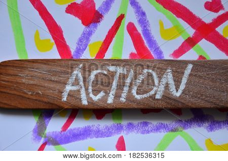 WORD ACTION ON A  ABSTRACT COLORFUL BACKGROUND