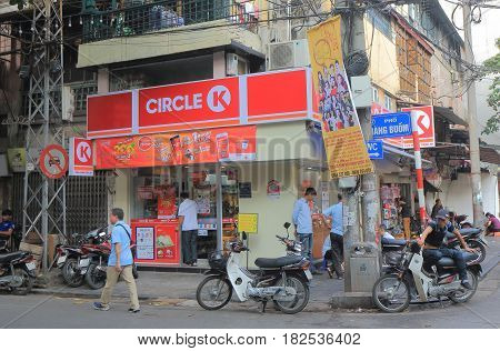 HANOI VIETNAM - NOVEMBER 23, 2016: Unidentified people visit Circle K convenience store in Old Quarter.